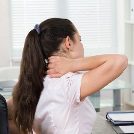42197409 - young businesswoman sitting on chair having backpain in office