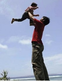 Father_lifting_child_into_air_IK-1067-07526-229x300